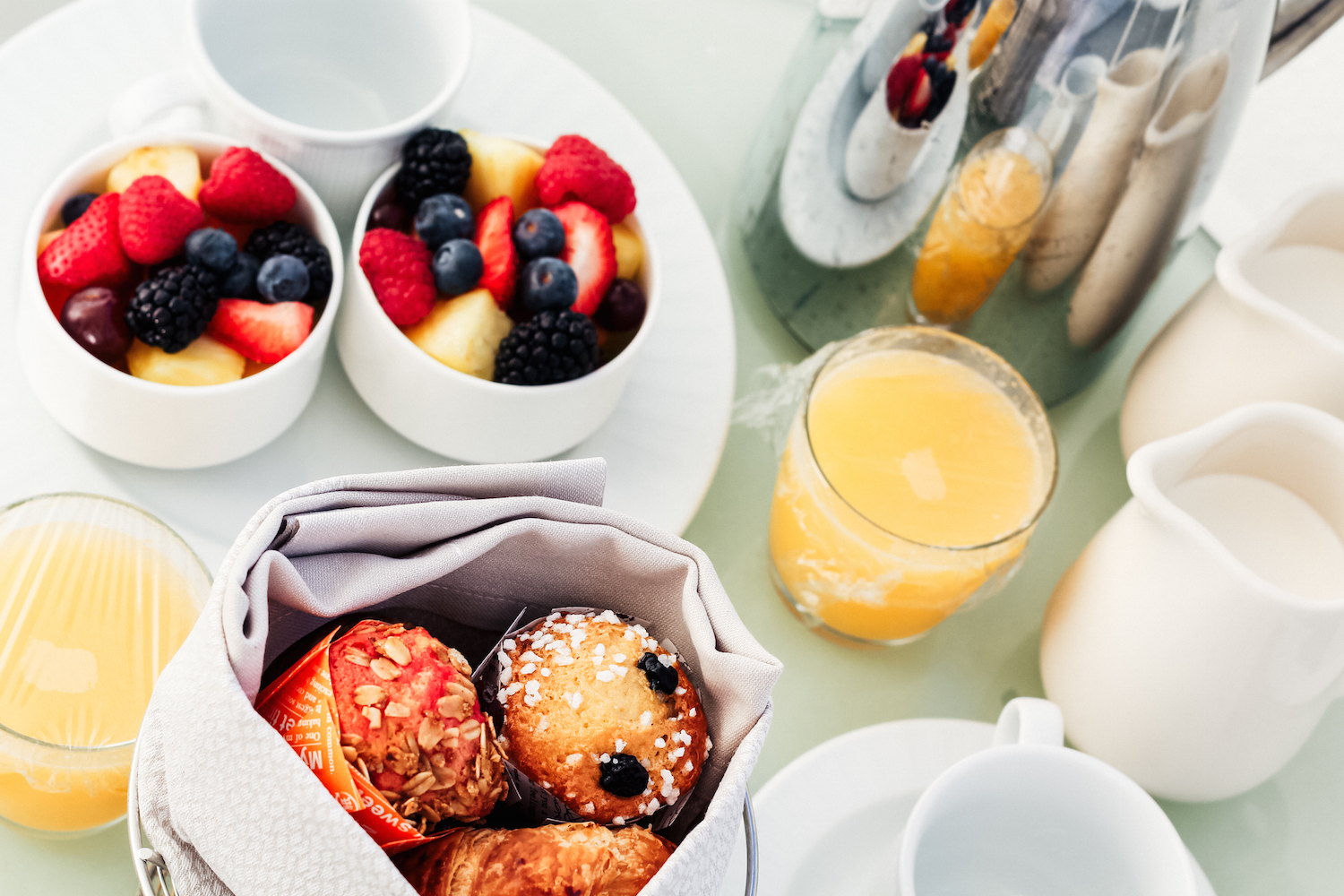 blueberry muffins with coffee and fruit