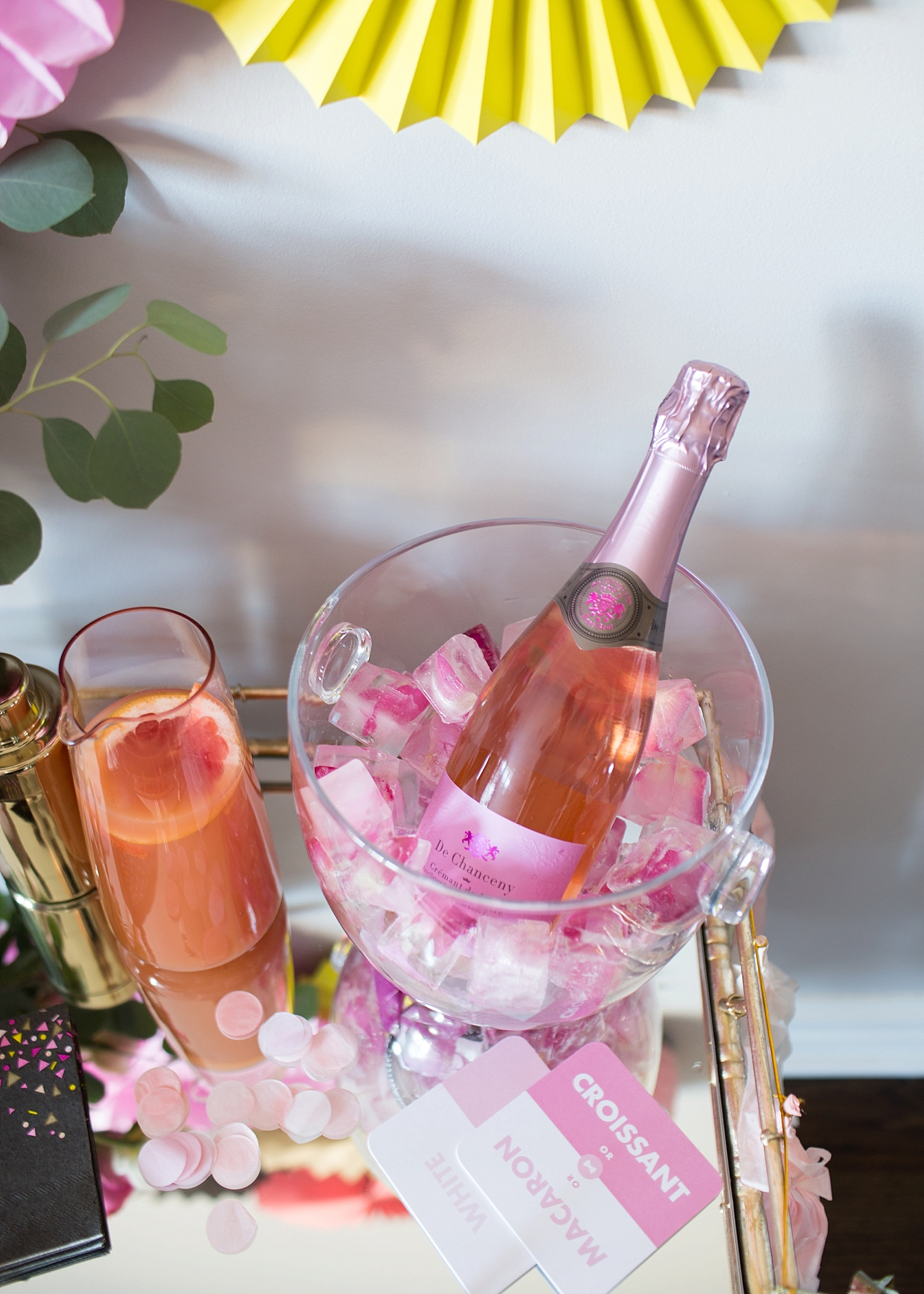 rose champagne over rose petal ice cubes